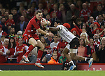 Wales wing George North cuts inside Waisea Nayacalevu.<br /> Dove Men Series 2014<br /> Wales v Fiji<br /> Millennium Stadium<br /> 15.11.14<br /> ©Steve Pope-SPORTINGWALES