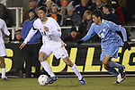 11 December 2009: Akron's Ben Zemanski (13) and UNC's Michael Farfan (19). The University of Akron Zips defeated the University of North Carolina Tar Heels 5-4 on penalty kicks after the game ended in a 0-0 overtime tie at WakeMed Soccer Stadium in Cary, North Carolina in an NCAA Division I Men's College Cup Semifinal game.