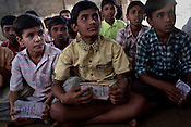 Children speak of their saving schemes they learn and the child rights they are made aware of in Wathorakurd, in Amrawati district of Maharashtra. The students study a specially designed concept of 'aflatoon' as part of the curriculam whereby they are made aware of their child rights as described in the convention of rights of child. These students are made aware of right to survival, right to protection, right to development and right to participation.