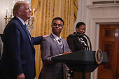 Ben Okereke, President of TPUSA Georgia State University speaks as United States President Donald J. Trump listens at the Young Black Leadership Summit 2019 at the White House in Washington, D.C. on Friday October 4, 2019.     <br /> Credit: Tasos Katopodis / Pool via CNP
