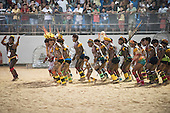 Kuikuro warriors perform a traditional celebration, 'danca dos macacos', to greet the public at the International Indigenous Games, in the city of Palmas, Tocantins State, Brazil. Photo © Sue Cunningham, pictures@scphotographic.com 25th October 2015