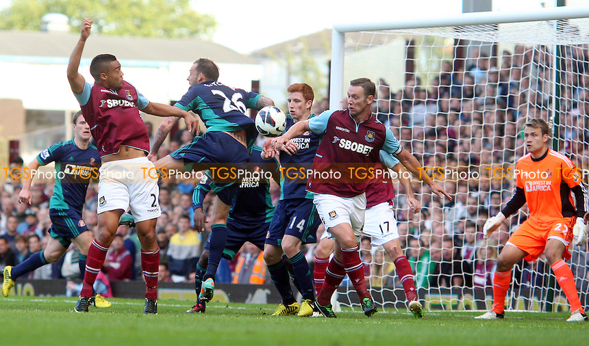 Winston Reid of West Ham gets in a header - West Ham United vs Sunderland - Barclays Premier League at Upton Park, West Ham - 22/09/12 - MANDATORY CREDIT: Rob Newell/TGSPHOTO - Self billing applies where appropriate - 0845 094 6026 - contact@tgsphoto.co.uk - NO UNPAID USE.
