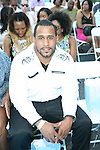 NFL Football Player Kareem Huggins  Attends Bikini Under The Bridge 2013 Fashion Show Held in BAM Parking Lot, Brooklyn NY