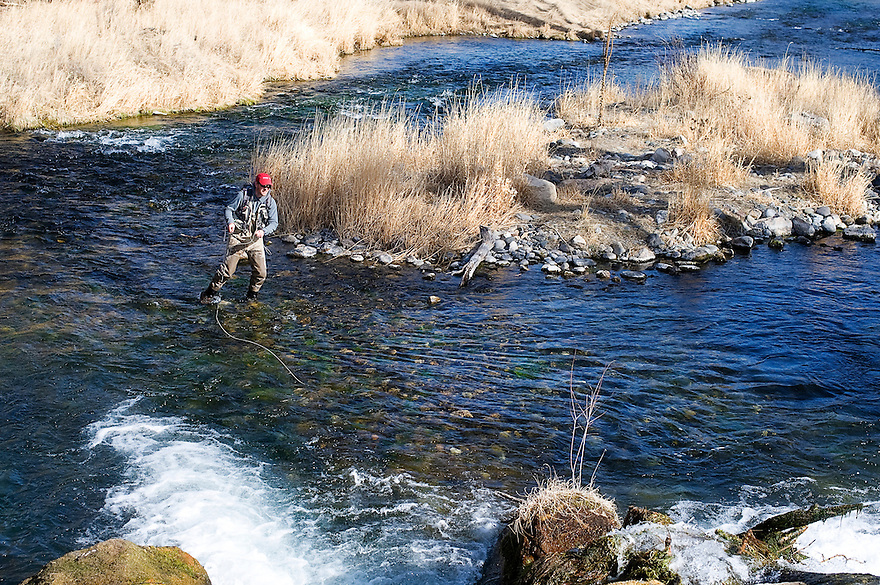 An angler casts on DePuy Spring Creek near Livingston, Montana.