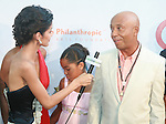 ANTM's Jaslene Gonzalez Interviews Russell Simmons for Global Grind at Russell Simmons' 12th Annual Art for Life East Hampton Benefit, NY 7/30/11