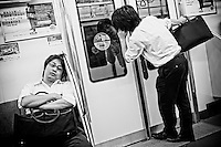 Salarymen take the last train home in Tokyo. According to a government survey in 2005, 23.4% of male workers in their 30s work more than 60 hours a week. .
