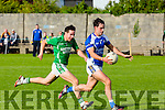 In Action KOR's Comac Coffey get away from  Maine's Pa Wrenn at the Garveys Senior Football Championship Kerins O'Rahilly V Milltown/Castlemaine at Strand Rd on Sunday