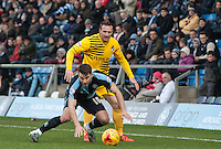 Liam Lawrence of Bristol Rovers pressures Matt Bloomfield of Wycombe Wanderers during the Sky Bet League 2 match between Wycombe Wanderers and Bristol Rovers at Adams Park, High Wycombe, England on 27 February 2016. Photo by Kevin Prescod.