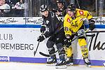 Chad Bassen (Nuernberg) und Thorsten Ankert (Krefeld) im Spiel der DEL, Nuernberg Ice Tigers (dunkel) - Krefeld Pinguine (hell).<br /> <br /> Foto © PIX-Sportfotos *** Foto ist honorarpflichtig! *** Auf Anfrage in hoeherer Qualitaet/Aufloesung. Belegexemplar erbeten. Veroeffentlichung ausschliesslich fuer journalistisch-publizistische Zwecke. For editorial use only.