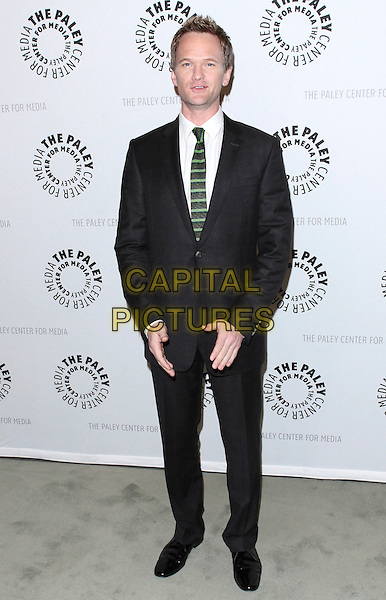 "NEIL PATRICK HARRIS .The Paley Center for Media presents ""How I Met Your Mother: 100th Episode Celebration"" held at The Paley Center for Media, Beverly Hills, California, USA,.7th  January 2010..full length black suit green striped tie white shirt .CAP/ADM/TC.©T. Conrad/AdMedia/Capital Pictures."
