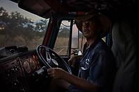 Nick Atkins, behind the wheel of his truck, on the Gibb River Road, on his way from Kununurra to Kalumburu.