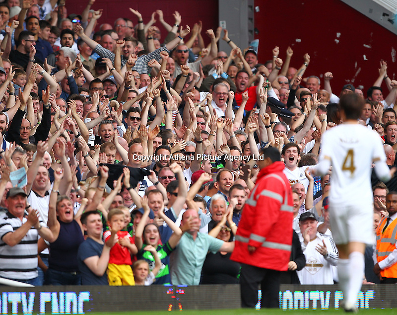 Ki Sung-yueng of Swansea celebrates scoring his sides third goal with Swansea fans   during the Barclays Premier League match between West Ham United and Swansea City  played at Boleyn Ground , London on 7th May 2016