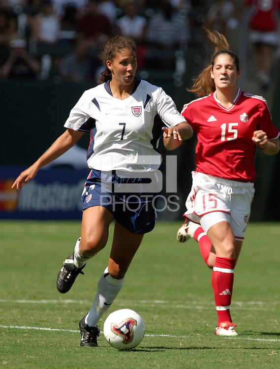 Shannon Boxx, left, Kara Lang, right, USA vs. Canada at the Third Place Match of the FIFA Women's World Cup USA 2003. USA 3, Canada, 1. (October 11, 2003). .