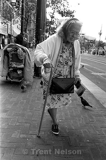 Old woman with cane. Leica hip shots on the street.<br />