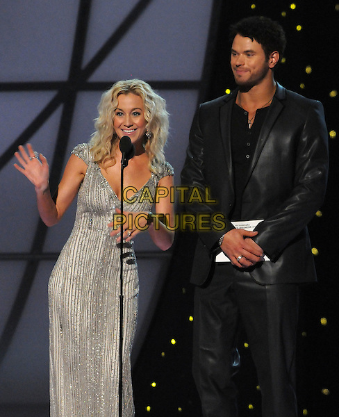 Kellie Pickler and Kellan Lutz.The 45th Annual CMA Awards, Country Music's Biggest Night, held at Bridgestone Arena, Nashville, Tennessee, USA..November 9th, 2011.on stage presenting black suit leather silver grey gray dress full length.CAP/ADM/LF.©Laura Farr/AdMedia/Capital Pictures.