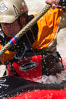 Close-up view of male paddler with water drops streaming off his face and body, whitewater kayaking at Teva Mountain Games, Vail CO.