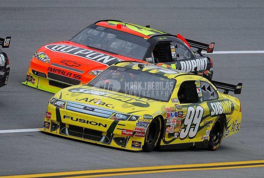 Oct. 30, 2009; Talladega, AL, USA; NASCAR Sprint Cup Series driver Carl Edwards (99) races alongside Jeff Gordon during practice for the Amp Energy 500 at the Talladega Superspeedway. Mandatory Credit: Mark J. Rebilas-