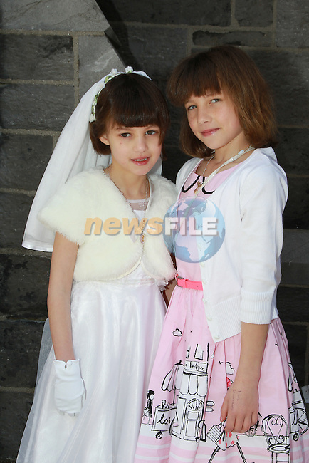 Megan and Roisin McDonagh.at first communion for Gaelscoil an Bhradáin Feasa.Picture  www.newsfile.ie..