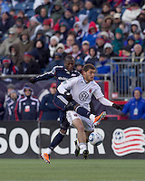 DC United defender Chris Korb (22) attempts to control the ball as New England Revolution forward Sainey Nyassi (17) defends. In a Major League Soccer (MLS) match, the New England Revolution defeated DC United, 2-1, at Gillette Stadium on March 26, 2011.