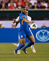 PHILADELPHIA, PA - JUNE 30: Jafar Arias #19 and Aaron Long #23 contest the ball during a game between Curaçao and USMNT at Lincoln Financial Field on June 30, 2019 in Philadelphia, Pennsylvania.