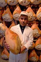 Langhirano,Parma, &egrave; conosciuta a livello mondiale per la produzione del Prosciutto di Parma. Tra le pi&ugrave; note &egrave; la ditta Galloni . ..Nella fabbrica Galloni parecchi lavoratori stranieri .Langhirano, Italy, near Parma, is the main center of production of the famous Prosciutto di Parma, Parma ham. The Galloni factory is one of the most important, in 50 years of activity..<br /> <br /> <br /> <br /> Parma ham, Prosciutto di Parma, Galloni, factory, Langhirano, Italia, cibo,alimenti, produzione alimentare, food, maiale, pork, made in Italy, lavoro, immigrato, work, extracomunitario, no Eu worker, sugnatore, immigrazione, immigrant,