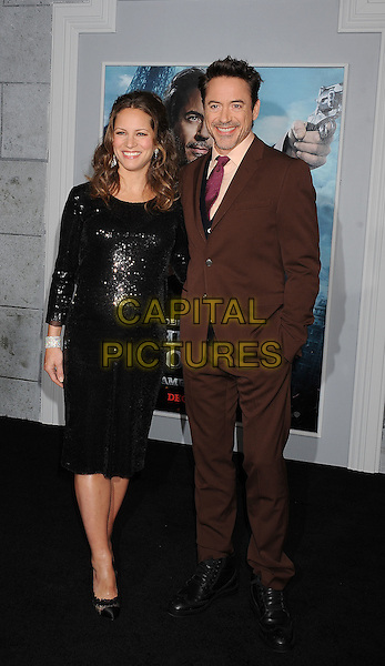 Susan Levin & Robert Downey Jr..The World Premiere of 'Sherlock Holmes: A Game of Shadows' held at The Village Theatre in Brentwood, California, USA..December 6th, 2011.full length married husband wife black sequins sequined dress pregnant brown suit hand in pocket pink tie blue cardigan .CAP/ROT/TM.©Tony Michaels/Roth Stock/Capital Pictures