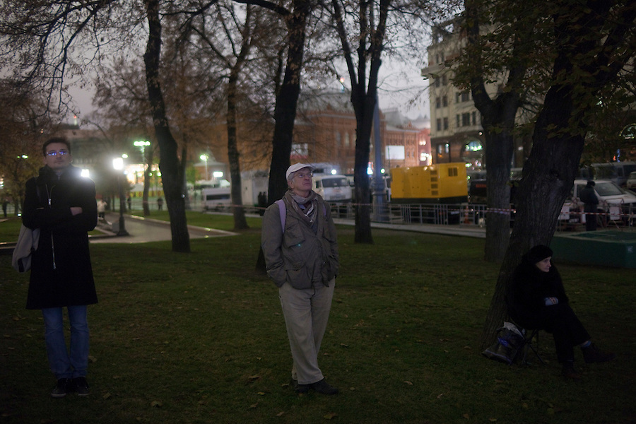 Moscow, Russia, 28/10/2011..People gather in Ploschad Revolutsii opposite the Bolshoi Theatre to watch the gala opening night on giant  outdoor video screens. The theatre had been closed since 2005 for reconstruction work that cost some $700 million.