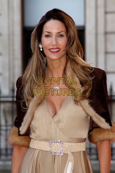 Lisa Butcher.Arrivals at the Royal Academy Summer Exhibition 2012 - preview party held at the Royal Academy of Arts, London, England..May 30th, 2012.half length black gold beige jacket cropped dress cleavage belt.CAP/AH.©Adam Houghton/Capital Pictures.