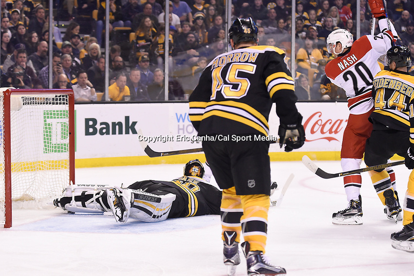 Thursday, March 10, 2016: Boston Bruins goalie Tuukka Rask (40) traps the puck under his ankle just shy of the goal line during the National Hockey League game between the Carolina Hurricanes and the Boston Bruins held at TD Garden, in Boston, Massachusetts. Carolina beats Boston 3-2 in overtime. Eric Canha/CSM
