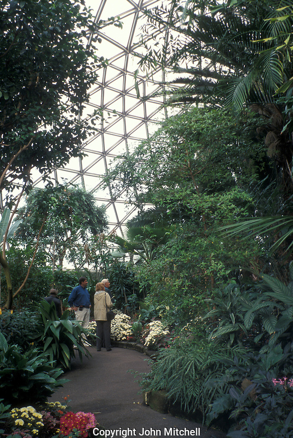 Tourists looking at birds in the Bloedel Floral Conservatory in Queen Elizabeth Park, Vancouver, British Columbia, Canada