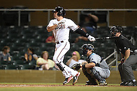 Salt River Rafters catcher/infielder Peter O'Brien (34) at bat in front of catcher Justin O'Conner and umpire Tom Honec during an Arizona Fall League game against the Peoria Javelinas on October 17, 2014 at Salt River Fields at Talking Stick in Scottsdale, Arizona.  The game ended in a 3-3 tie.  (Mike Janes/Four Seam Images)