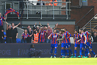 Wilfred Zaha of Crystal Palace celebrates the opener infront of the Crystal Palace fans during Crystal Palace vs Brighton & Hove Albion, Premier League Football at Selhurst Park on 14th April 2018