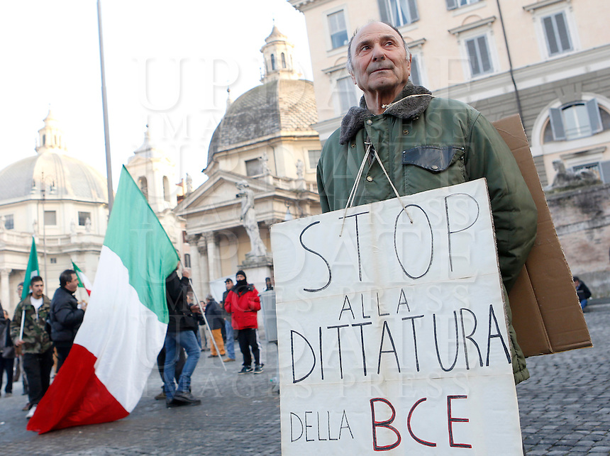 Manifestazione del Movimento dei Forconi contro le politiche di austerita' del governo, le tasse e la disoccupazione, in Piazza del Popolo a Roma, 18 dicembre 2013.<br /> Pitchforks Movement's protesters gather against government's austerity measures, taxes and unemployment in Rome, 18 December 2013. The sign reads &quot;Stop to ECB dictatorship&quot;.<br /> UPDATE IMAGES PRESS/Riccardo De Luca