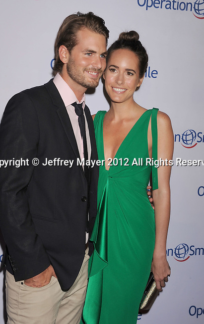 BEVERLY HILLS, CA - SEPTEMBER 28: Josh Slack and Louise Roe attend Operation Smile's 30th Anniversary Smile Gala - Arrivals at The Beverly Hilton Hotel on September 28, 2012 in Beverly Hills, California.