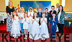 """Abbie NÌ Sh˙illeabh·in, Aoife Wright, Bea NÌ Loingsigh, D˙nlaith NÌ Ghealbh·in, Emma NÌ Ruairc, Si˙n Ni GhrifÌn, Ashton """" Maiti˙, Fionn """" D˙bhda, Jack """" Dearg·in, Muiris """" Conch˙ir, and Thomas """" Gealbh·in the day of their First Communion in SeipÈal Naomh Eoin Baiste, Lios PÛil, on Saturday, here pictured with Fr Jim Sheehy and teachers EibhlÌn RuisÈal and Geraldine Ashe."""