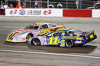 June 5, 2010. Las Vegas, NV: Dustin Ash and Scott Gafforini connect after a spin at the Bullring at LVMS in Las Vegas, NV.