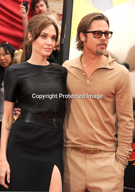 "HOLLYWOOD, {CA} -MAY 22: Angelina Jolie and Brad Pitt arrive at the Los Angeles premiere of ""Kung Fu Panda 2"" held at Grauman's Chinese Theatre on May 22, 2011 in Hollywood, California."