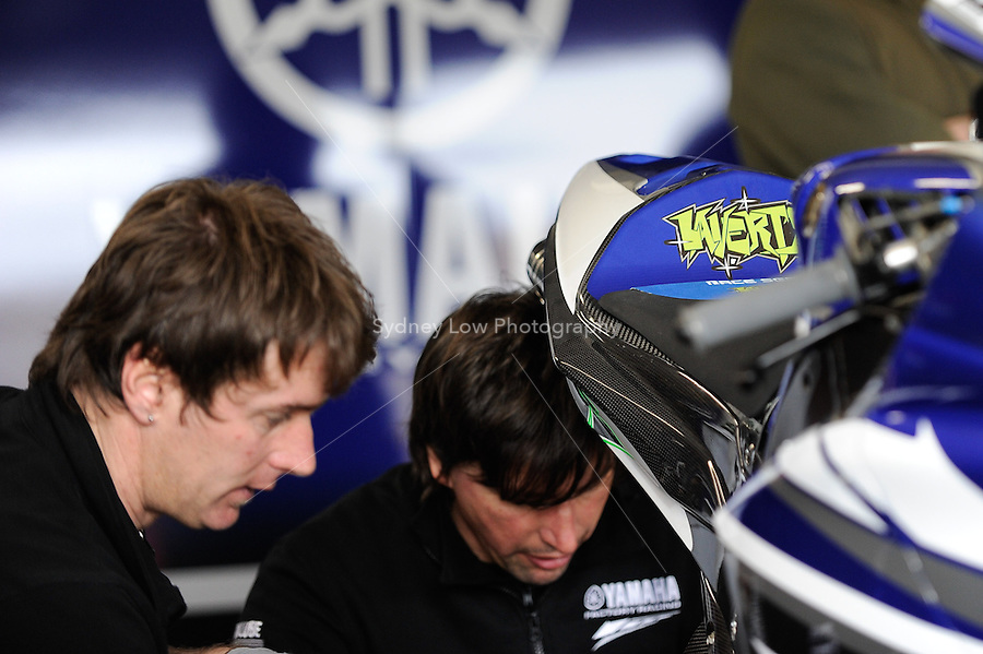 PHILLIP ISLAND, 22 FEBRUARY - Mechanics at work in the Yamaha World Superbike Team pits at day two of the testing session prior to round one of the 2011 FIM Superbike World Championship at Phillip Island, Australia. (Photo Sydney Low / syd-low.com)