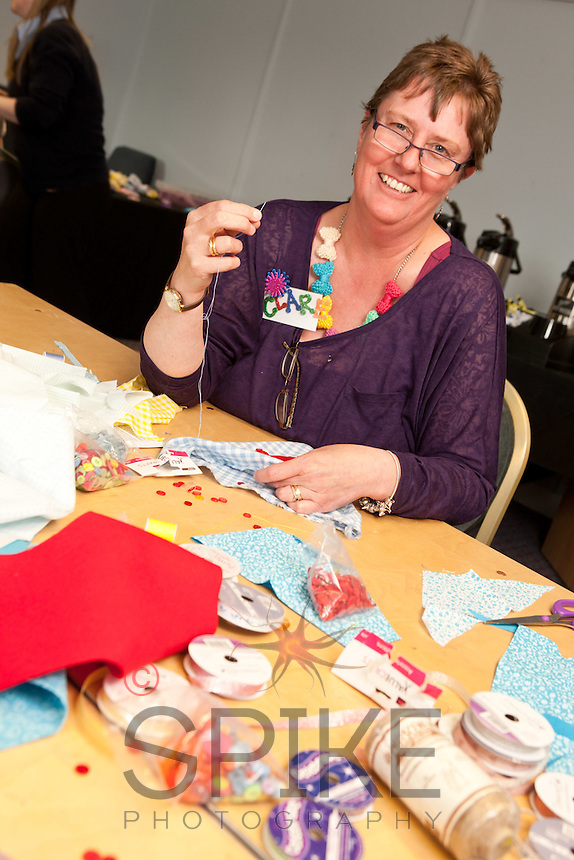 Staff experienced an unsual induction training day for the soon to be opened Derby Hobbycraft store. Having fun with bunting is Clare Leeson