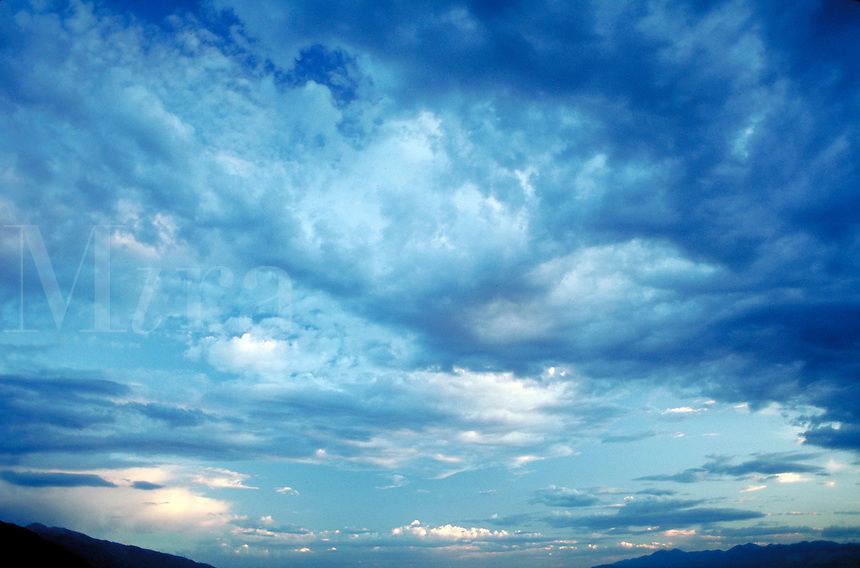 Soft clouds rushing away. Airy, light, calm, serenity, serene. Connotations - Religious, power, new beginnings. at least 6 different shades of blue visible.