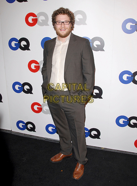 SETH ROGEN.The 2007 GQ Men of the Year Celebration at Chateau Marmont in West Hollywood, California, USA..December 5th, 2007.full length grey gray suit hands in pockets brown shoes beard facial hair glasses .CAP/DVS.©Debbie VanStory/Capital Pictures