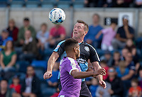 Garry Thompson of Wycombe Wanderers wins the ball in the air during the Sky Bet League 2 match between Wycombe Wanderers and Plymouth Argyle at Adams Park, High Wycombe, England on 12 September 2015. Photo by Andy Rowland.