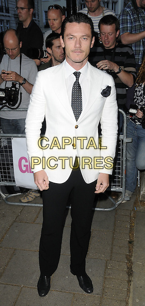 Luke Evans.Glamour Women Of The Year Awards held at Berkeley Square Gardens, London, England..June 7th 2011.full length black trousers white suit jacket tie blue .CAP/CAN.©Can Nguyen/Capital Pictures.