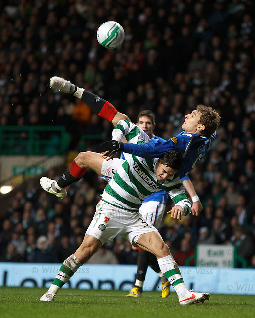 Nikica Jelavic attempts an overhead kick above Beram Kayal