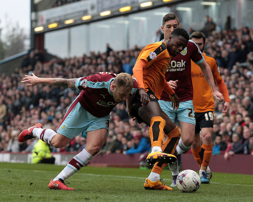 Burnley's Scott Arfield battles with Wolverhampton Wanderers' Jeremy Helan<br /> <br /> Photographer David Shipman/CameraSport<br /> <br /> Football - The Football League Sky Bet Championship - Burnley v Wolverhampton Wanderers - Saturday 19th March 2016 - Turf Moor - Burnley<br /> <br /> &copy; CameraSport - 43 Linden Ave. Countesthorpe. Leicester. England. LE8 5PG - Tel: +44 (0) 116 277 4147 - admin@camerasport.com - www.camerasport.com