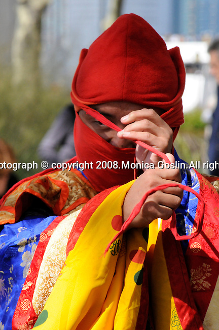 A Bhutan Monks prepares to perform in New York City.