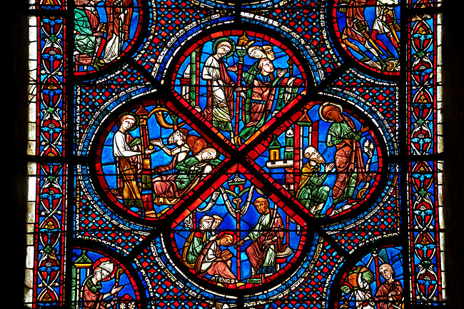 Medieval Windows  of the Gothic Cathedral of Chartres, France, dedicated to the life an miracles of St Nicholas. A UNESCO World Heritage Site. Bottom corner shows During a famine, Nicholas persuades sailors to give the town some grain, bottom left shows The sailors bringing grain ashore . Centre panel bottom, The young St Nicholas does well at school, left Nicholas secretly gives gold to an old man to save his daughters , right The old man tries to thank Nicholas, who humbly flees from him, top .Nicholas is chosen to be the new Bishop of Myra.