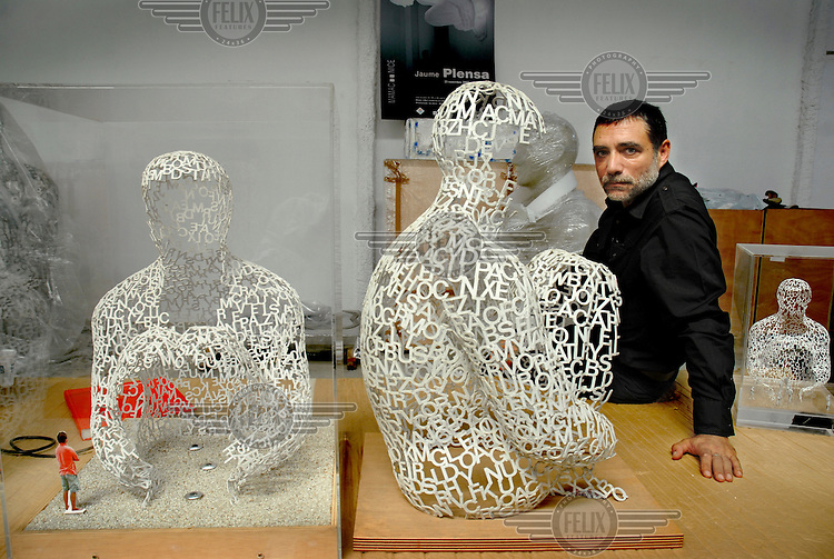 Catalonian artist and sculptor Jaume Plensa with some of his stainless steel sculptures.