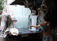 An ice truck makes a delivery to a customer in Bangkok's Chinatown.