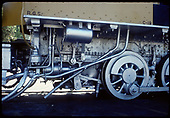 Close-up view of engineer's-side firebox area of RGS #40 engine with wheels, steam valves, etc. at Knott's Berry Farm.<br /> RGS  Buena Park, CA